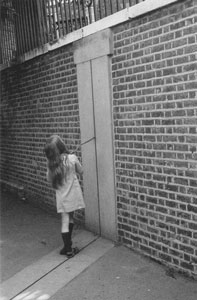 Photo of a girl with a stick on the Greenwich Meridian line